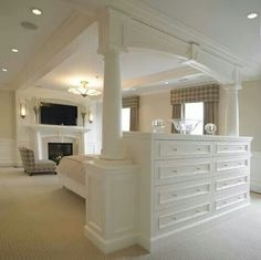 I don't like the overhead structure, but love the idea of using a bank of drawers or other storage as a room divider.