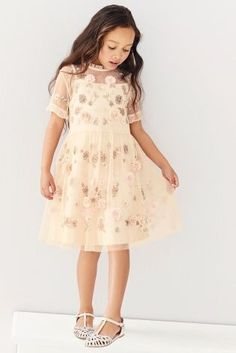 Spring weddings call for embellishments - and this little princess has nailed it with her dress choice!