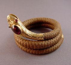 Victorian snake coil bracelet, 14K gold, garnets and a woven real hair band, c. 1880