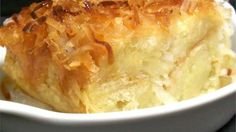 The classic bread pudding is enhanced with coconut flakes and coconut milk.