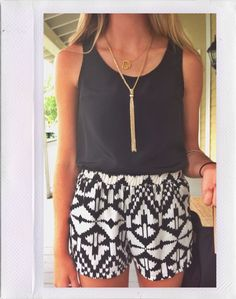 cloth black & white patterned shorts + solid green tank + long gold necklace