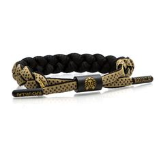 Black/Gold Classic Bracelet Featuring perforated color reflective film, enamel hardware and contrast emblems. 100% Polyester. One Size Fits Most.