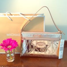 GOLD ROSÉ Large Wristlet from Michael Kors New and authentic wristlet from MK in gold rosé. Super cute small bag or big wristlet. Store bag is included! Michael Kors Bags Clutches & Wristlets
