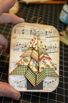 The Little Blue House: LBH 12 Days of Ornaments: Day .this would be so pretty on a card. Christmas Ornaments To Make, Noel Christmas, Christmas Gift Tags, Handmade Christmas, Holiday Crafts, Christmas Decorations, Christmas Ideas, Sheet Music Crafts, Theme Noel