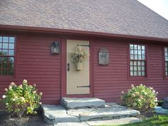 photo of primitive homes inside cave Colonial House Exteriors, Colonial Exterior, Red Houses, Saltbox Houses, Exterior Paint Colors, Exterior House Colors, Colonial Front Door, Front Doors, Garage Doors
