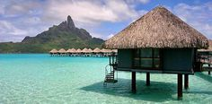 How to Plan Your Honeymoon in Bora Bora. Bora Bora is a small French Polynesian island in the Pacific Ocean, located northwest of Tahiti. Because of its warm climate and paradisiacal landscape, the island is a popular spot for. Oh The Places You'll Go, Cool Places To Visit, Places To Travel, Travel Destinations, Holiday Destinations, Dream Vacations, Vacation Spots, Resorts, Bora Bora Bungalow