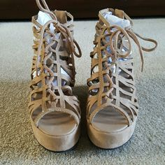 H&M wedges NWOT Lace up and zips in the back. Never worn! Cute with Capris or sundresses. Says it's a US 7, EUR 38 but I usually wear a 7.5 or 8 so it fits a little bigger Divided by H&M Shoes Wedges