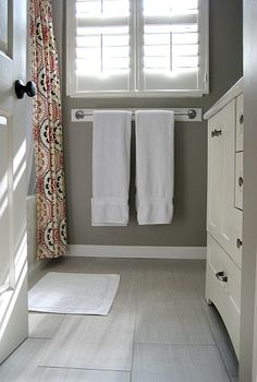 Gray budget bathroom remodel. Love the floor and wall color