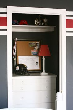 A redesigned boys bedroom closet becomes a place to store clothing and more ~ they have sports equipment and a trophy shelf in there.