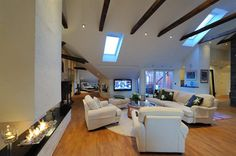 Fantastic modern Stockholm Apartment. Wooden beams, downlights, Englesson sofa. Modern fireplace. Ceiling windows.