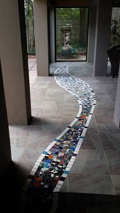 I love the way this flooring idea creates smooth movement between the indoor and outdoor spaces , great design idea to use in a more contemporary way with either hard, stone or industrial flooring in your interior home design Mosaic Details and Floors Stone Mosaic, Mosaic Glass, Fused Glass, Stained Glass, Glass Art, Mosaic Wall, Mosaic Tiles, Mosaic Floors, Tiling