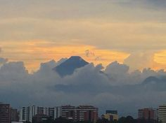 Agua Volcano among the clouds and next to Guatemala City