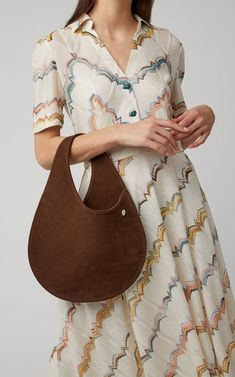 Designer Marin Hopper, daughter of legendary actor Dennis, channeled her glamorous Hollywood family history into a range of luxe handbags that includes this teardrop-shaped style. Brown Suede, Fashion Bags, Saddle Bags, Creations, Women Wear, Boxing, Glamour, Fashion Design, Clothes