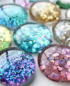 "#DIY Glitter Magnets - cute craft idea for kids. Made with dollar store ""marbles"" and glitter."