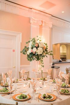 Soft green eucalyptus and trailing ivy for elevated centerpiece at romantic Lakeside Country Club wedding. Flowers by Fleur de Vie Houston.Photography by Brittany Jones.