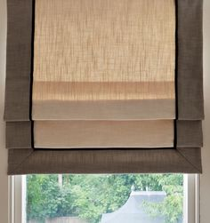 Roman shade in neutral coloured linen with darker contrast bandings