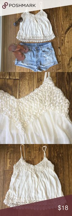 Andree white crochet tank SUPER CUTE white tank top! So sad to see this adorable top go! Cute detail along the bottom, and neckline, v-neck shape, no tears, great condition! Make me an offer! Andree Tops