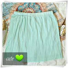 "JustFab Pleated mini skirt in mint  Cute mini skirt in mint / green with beautiful pleated detailing make it dashingly flowy to wear day to night. Pull on construction. Fully lined. Goes great with pantyhose during colder months.  Details: length 15"", waist 26"", stretches maximum to 36"", 100% polyester. JF Skirts Mini"