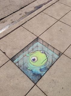 Trompe l'oeil chalk art on the streets of Ann Arbour Michigan by illustrator David Zinn, who's been adding whimsical anamorphics to the walls and pavements there since 2001.