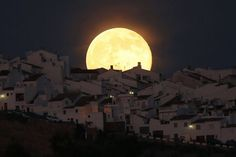 another-image-of-the-supermoon-this-one-as-it-rises-over-houses-in-olvera-in-the-southern-spanish-province-of-cadiz-on-july-12-2014-was-a-popular-image-on-reuters-instagram