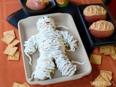 Creepy+Halloween+Appetizers   Jazz up a regular ol' cheese ball for Halloween by turning it into a ...