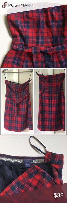 """Plaid Wool Dress Strapless plaid dress. Matching belt attached and included. Red and navy with pink accent. Fully lined. Shell is 70% Wool / 30% Viscose. Lining is 100% Acetate. Dry clean only. Side zip with two button closure at top of zipper. Total length is about 29"""" from top of neckline to hem. Bodice is about 9"""" from neckline to waist/belt. Skirt is about 20"""". I'm 5'2 and this hit me at the top of my knee. Previously loved and in great condition. American Eagle Outfitters Dresses…"""