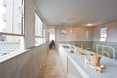 Extraordinary Contemporary Home Design in Japan: Long And Narrow Kitchen Shape In K House Applied Concrete Wall And Wooden Floor Lit Up By S. Concrete Design, Concrete Wall, Japanese Architecture, Interior Architecture, Interior Design Kitchen, Bathroom Interior, Osaka, Blog Design Inspiration, Narrow Kitchen