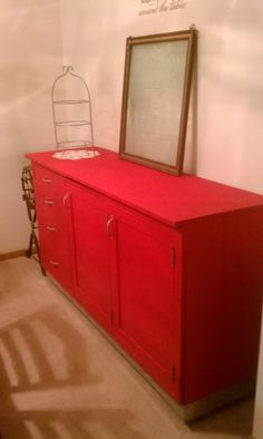 old 50s kitchen cabinet re-purposed into a buffet