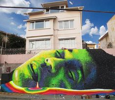 Artist Dasic Fernandez, a Chileanfrom Santiago now based in New York, who creates some huge colorful murals with gr