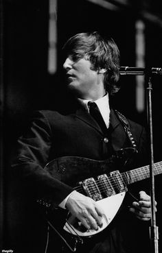 "John in concert in Stockholm, 1964. Scanned from ""Beatles Memorabilia: The Julian Lennon Collection"""
