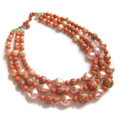 "This is a super colorful Vintage Three Strand Mad Men Lucite Necklace in Satin Pink, Orange and Gold with Red Speckled Beads!  This necklace measures 15"" in length from end... #teamlove #ecochic #vogueteam"