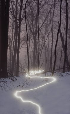 I have highlighted this image because I like how the image is simple yet effective at demonstrating how light can be used in photography. This image was created with a high exposure setting which would more light in the image such as the trail, The trail would've been created by a person walking along with a torch held above the ground.