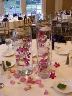 Mixed floating candle and flower submerged centerpiece