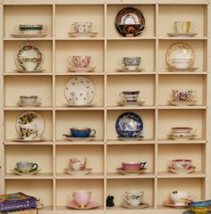 since my original collection was smashed, i have been given so many tea cups by kind and generous friends and strangers. these are most of them (not hanging on the wall any more, but set on a table).