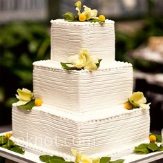really like the simplicity of this cake... minus the yellow flowers