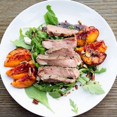 Grilled Ribeye, Grilled peaches with arugula, blue cheese, toasted pecans, thyme and honey balsamic dressing.