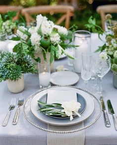 pale blue + succulents, greenery, and white florals.