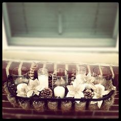 My own craft for pinterest! A winter flower box :)   All dollar store things (though admittedly I lightly spray painted the pine cones w gold I already had) think it turned out awesome.