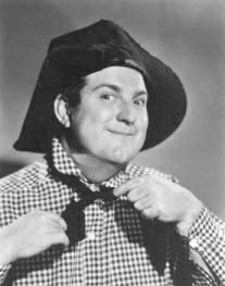 Smiley Burnette, a sidekick for many silver screen cowboys, was also an accomplished songwriter and musician (he played well over 100 instruments!). His comic songs and antics brought laughter to many, and he is one of the most beloved sidekicks of the Western genre.