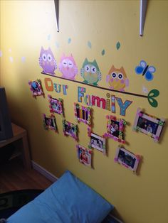 Family photos wall at daycare so the kids can see their family all day long