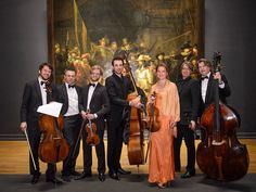 Camerata RCO in front of the most famous painting in the world, the Night Watch by Rembrandt van Rijn.
