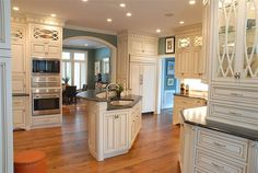 Functional Elegance!  Custom Cabinets painted with glazing and Soapstone countertops.