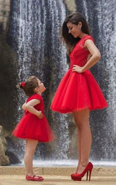 Mom & daughter In the red dress on....