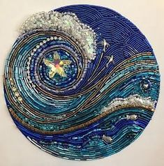 StarSwept is a blue, silver, and gold beaded mosaic original by Diana Maus. Two birds fly outward from a Swarovski crystal starfish on a joyous wave. This ocean mosaic is dia. on wood panel. Ready to hang or freestand on a shelf or table. Bead Embroidery Patterns, Bead Embroidery Jewelry, Beaded Embroidery, Beading Patterns, Hand Embroidery, Beaded Jewelry, Art Textile, Fabric Beads, Beaded Brooch