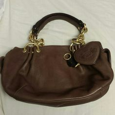 "Juicy Couture Purse Brown Juicy Couture purse in great condition. No noticeable wear on both interior and exterior. Includes pocket for cell phone and magnetic pockets on exterior as well. Approximately 1' wide and 6"" tall Juicy Couture Bags"