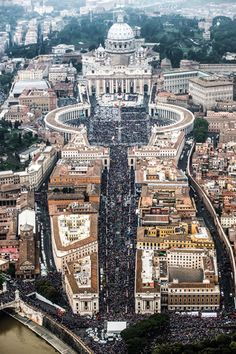 A large crowd is seen in and around St. Peter's Square as Pope Francis celebrates the canonization Mass for Sts. John XXIII and John Paul II at the Vatican April 27.