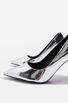 The heeled court shoe gets an angular update with this detailed design in metallic silver.