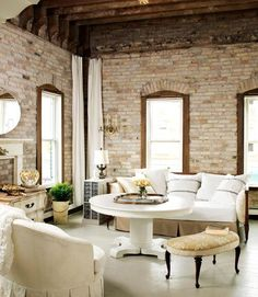 WOW. My dream exposed-brick-walls-plus-all-white-furniture kind of living room.