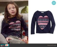 Lily's navy patterned heart sweater on Modern Family.  Outfit Details: https://wornontv.net/56594/ #ModernFamily