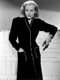 Hollywood Actress Carole Lombard, wearing a 1930's black dress.